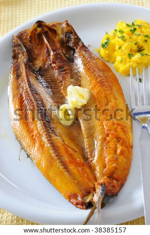 Fresh smoked kipper with scrambled egg - stock photo
