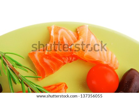 fresh smoked red fish fillet on plate and rosemary