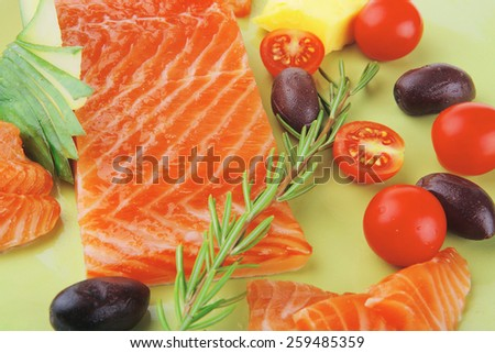 fresh smoked salmon fillet with vegetables and rosemary - stock photo