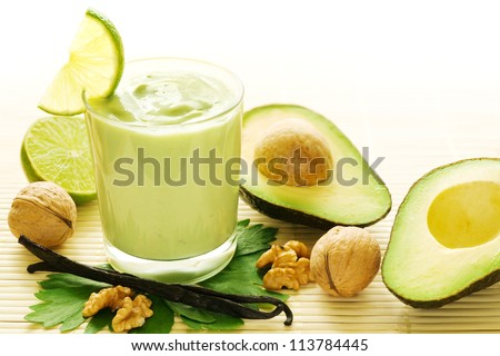 Fresh smoothie of avocados, vanilla, walnuts and limes - stock photo