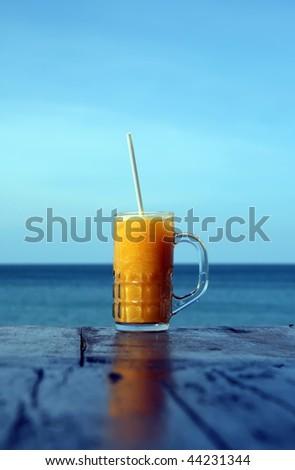 Fresh smoothie on a beach - stock photo