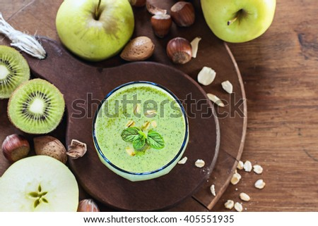 Fresh smoothie with apple,kiwi  on dark wooden background. top view. - stock photo