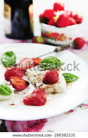 fresh soft  sheep cheese with strawberry and balsamic vinegar