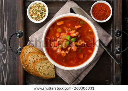 Fresh solyanka on a tray on a wooden background - stock photo