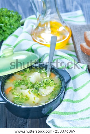 fresh soup in bowl and on a table - stock photo