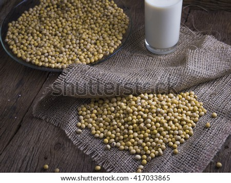 Fresh soy milk and raw soy bean - stock photo
