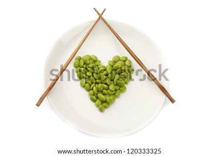 Fresh soybeans on a white plate with chopsticks - stock photo