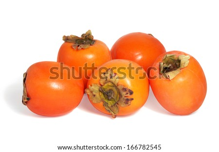 Fresh spanish persimmons on white background. - stock photo