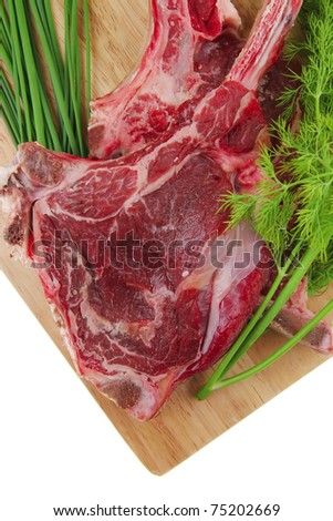 fresh spare ribs : raw pork with dill and green chives on wooden board isolated over white background - stock photo