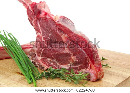 fresh spare ribs : raw pork with thyme and green chives on wooden board isolated over white background - stock photo