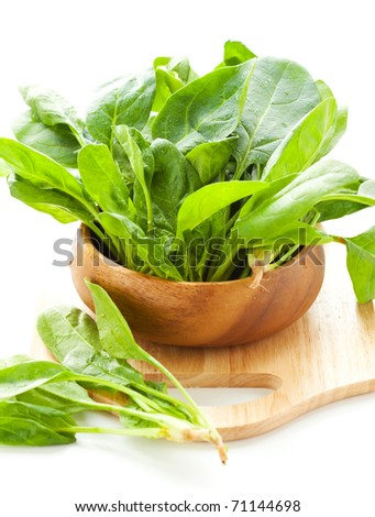 Fresh spinach in a wooden bowl - stock photo