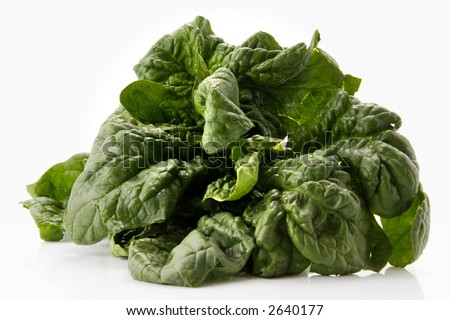fresh spinach leaves over white background