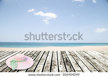 Fresh spring green grass with blue sky ,and wood floor background - stock photo