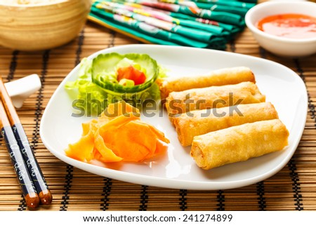 fresh spring rolls with vegetables on chinese dishware. - stock photo