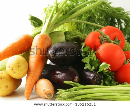 fresh spring vegetables - carrots, tomatoes, asparagus, eggplant and potatoes - stock photo