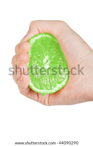Fresh squeezed green lime with hand isolated on a white background