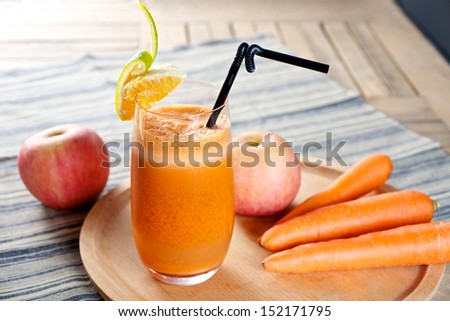 Fresh squeezed organic natural carrot and apple juice - stock photo