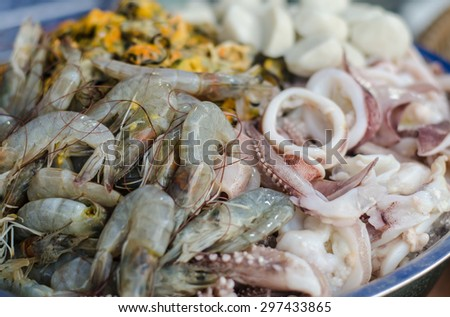 Fresh Squid and shrimp in the seafood market . - stock photo