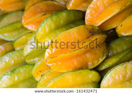 Fresh star fruit on display from fruit and vegetable market. - stock photo