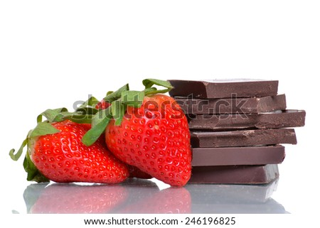 fresh strawberries and chocolate pieces isolated on white background - stock photo