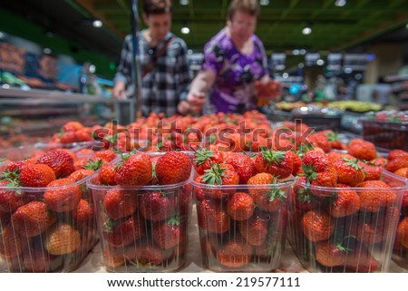 fresh strawberries at the grocery store - stock photo