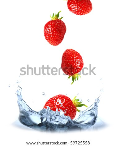 Fresh strawberries dropped into the water