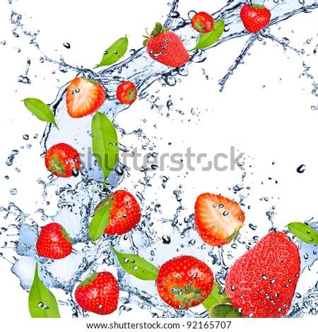 Fresh strawberries falling in water splash, isolated on white background - stock photo