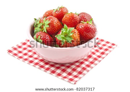 Fresh strawberries in a pink bowl isolated over white - stock photo