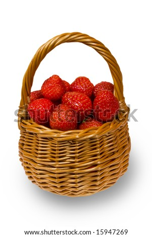 Fresh strawberries in a small basket - stock photo