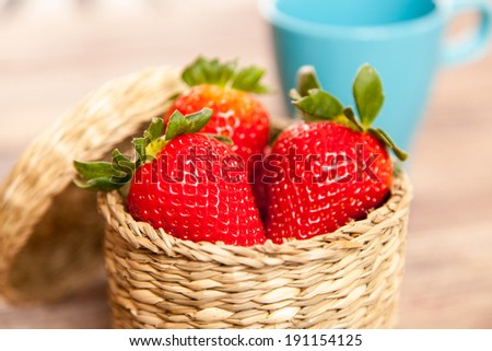 Fresh strawberries in a wicker basket