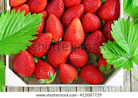 fresh strawberries in a wooden box