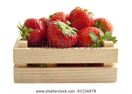 Fresh strawberries in a wooden crate isolated over white - stock photo