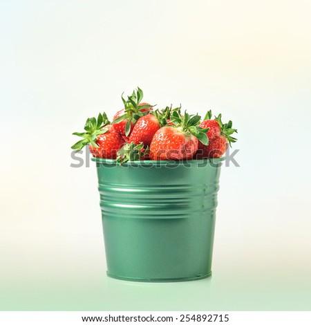 Fresh strawberries in bucket - stock photo