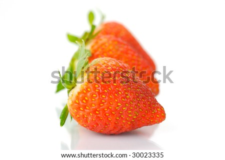 Fresh strawberries isolated against a white background