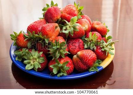 Fresh strawberries on a platter - stock photo