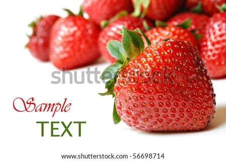 Fresh strawberries on white background with copy space.  Macro with shallow dof. - stock photo