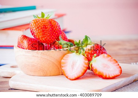 Fresh strawberries on wooden table. - stock photo
