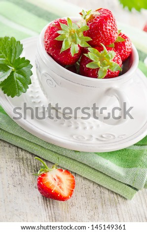 Fresh strawberries on  wooden table .Selective focus