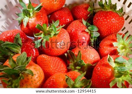 Fresh strawberries ready to be prepared - stock photo