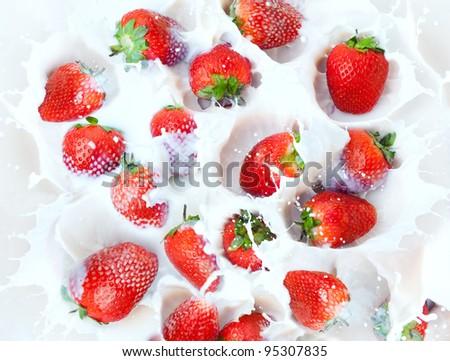 Fresh strawberry and milk splashes - stock photo
