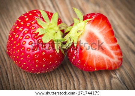 Fresh Strawberry close up on the wood - stock photo