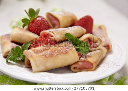 Fresh Strawberry Crepes Rolls with Mint for Breakfast - stock photo