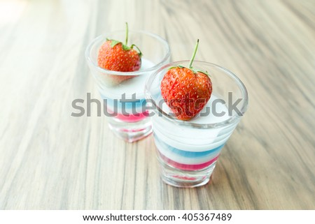 fresh strawberry decoration on jelly in shot glass