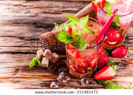 Fresh strawberry drink on wood background  - stock photo
