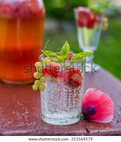 Fresh strawberry drink on wood background outdoor.