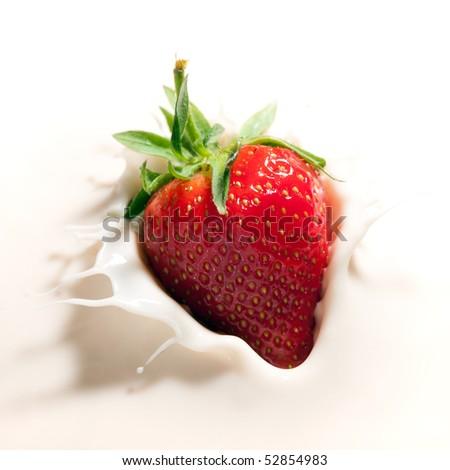 fresh strawberry dropped in yogurt with splashes - stock photo
