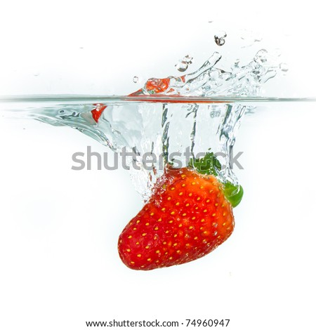 fresh strawberry dropped into water with splash on white backgrounds - stock photo