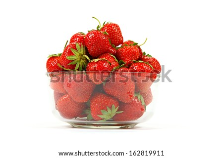 Fresh strawberry fruit in a glass dish isolated on a white background. - stock photo