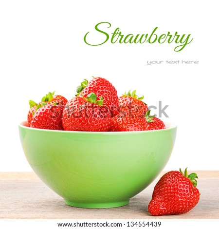 Fresh strawberry in a bowl isolated over white - stock photo