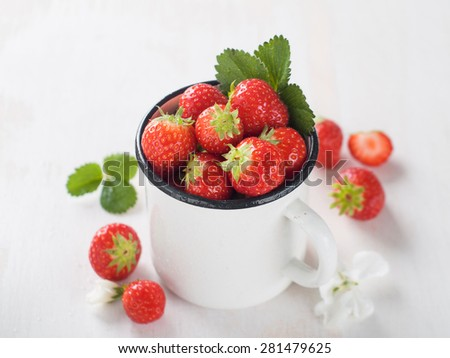 Fresh strawberry in cup, selective focus - stock photo